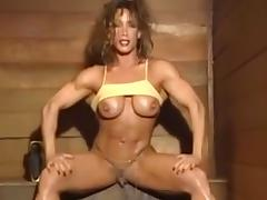 A female bodybuilder showing her large clitoris in the sauna. tube porn video