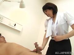 A slutty Japanese MILF strokes and rides a dick in a hospital tube porn video