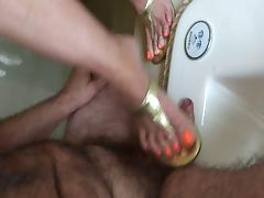 Shoejob with orange polish tube porn video
